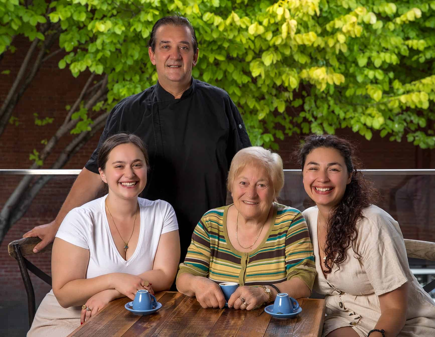 two sisters Natalie and Thierry with Greek yiayia Eleni and chef Hristos standing above them
